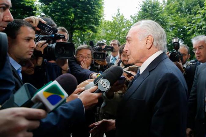 Michel Temer fala a imprensa em Hamburgo, na Alemanha. Foto: Rogério Melo/PR