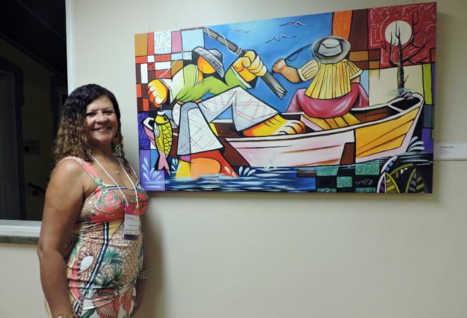 A artista Carmem Lúcia é uma das expositoras e participante da exposição há quatro edições